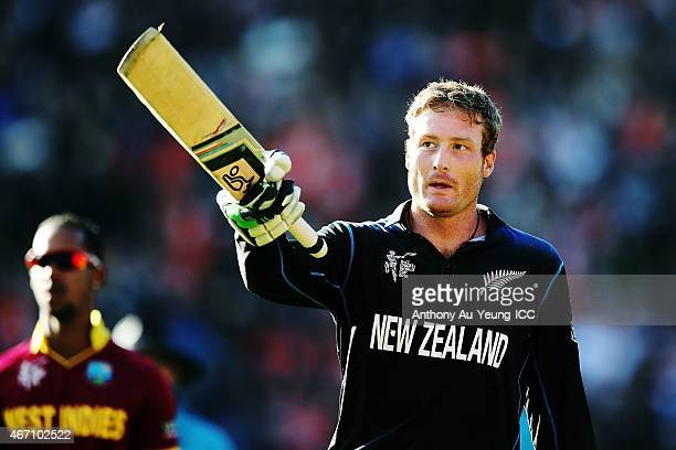 Martin Guptill of New Zealand celebrates as he comes off the field after scoring 237 runs not out during the 2015 ICC Cricket World Cup match between...