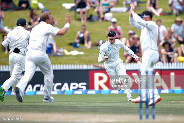 Martin Guptill of New Zealand celebrates catching out Dinesh Chandimal of Sri Lanka during day three of the Second Test match between New Zealand and...