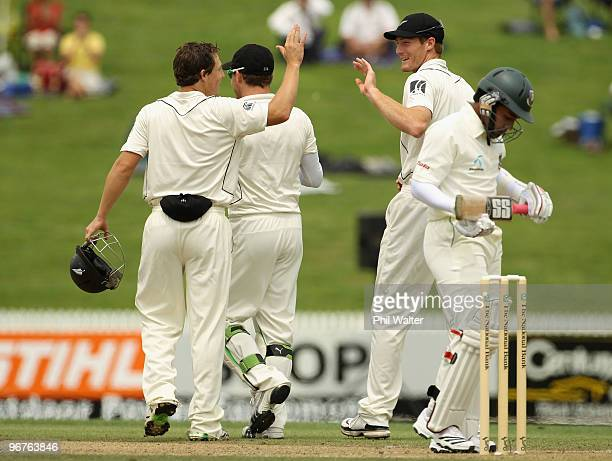 Martin Guptill of New Zealand celebrates his catch of Mushfiqur Rahim of Bangladesh during day three of the First Test match between New Zealand and...