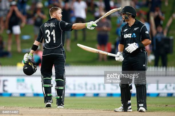 Martin Guptill of New Zealand celebrates his century alongside Ross Taylor during game four of the One Day International series between New Zealand...