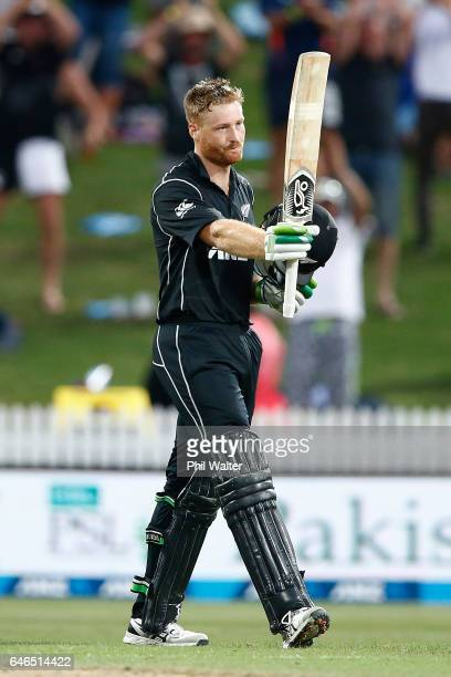 Martin Guptill of New Zealand celebrates his century during game four of the One Day International series between New Zealand and South Africa at on...