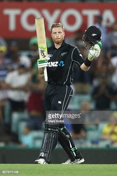 Martin Guptill of New Zealand celebrates his century during game one of the One Day International series between Australia and New Zealand at Sydney...