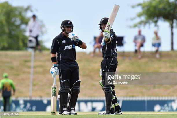 Martin Guptill of New Zealand celebrates his half century during the second match in the One Day International series between New Zealand and...
