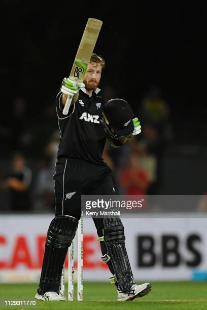 Martin Guptill of New Zealand celebrates scoring 100 runs during Game 1 of the One Day International series between New Zealand v Bangladesh at...