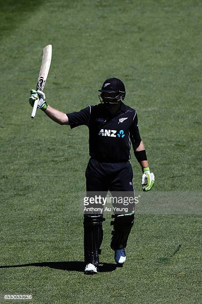 Martin Guptill of New Zealand celebrates scoring a half century during the first One Day International game between New Zealand and Australia at Eden...