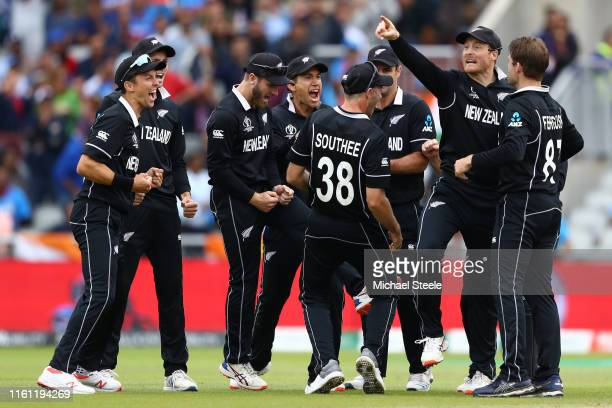 Martin Guptill of New Zealand celebrates with team mates after running out MS Dhoni during the SemiFinal match of the ICC Cricket World Cup 2019...