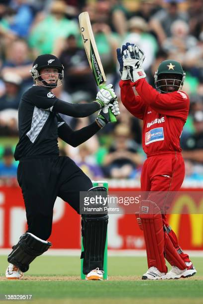 Martin Guptill of New Zealand cuts the ball away for four runs during game two of the One Day International series between New Zealand and Zimbabwe...