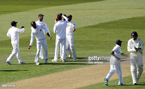Martin Guptill of New Zealand departs after being dismissed caught by Dinesh Chandimal of Sri Lanka off the bowling of Angelo Mathews during day one...