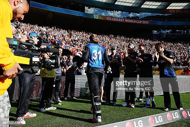 Martin Guptill of New Zealand is congratulated by the team coming off the field after scoring 237 runs not out during the 2015 ICC Cricket World Cup...