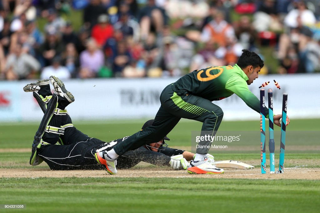Martin Guptill of New Zealand is run out by Shadab Khan of Pakistan during the third game of the One Day International Series between New Zealand and Pakistan at University of Otago Oval on January 13, 2018 in Dunedin, New Zealand.