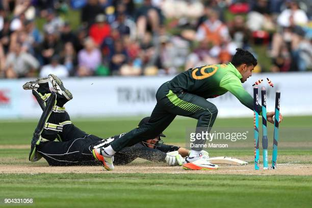 Martin Guptill of New Zealand is run out by Shadab Khan of Pakistan during the third game of the One Day International Series between New Zealand and...