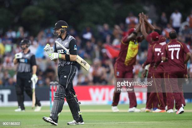 Martin Guptill of New Zealand leaves the field after being dismissed by Sheldon Cottrell of the West Indies during game two of the Twenty20 Series...
