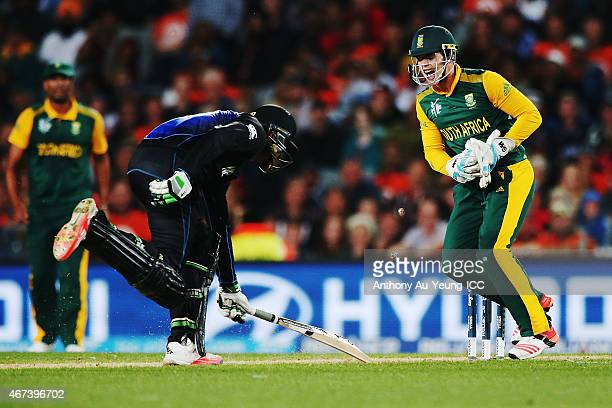Martin Guptill of New Zealand runout as Quinton de Kock of South Africa reacts during the 2015 Cricket World Cup Semi Final match between New Zealand...
