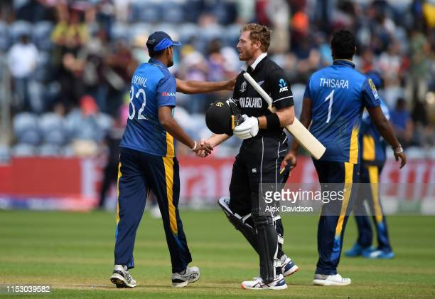 Martin Guptill of New Zealand shakes hands with Suranga Lakmal of Sri Lanka during the Group Stage match of the ICC Cricket World Cup 2019 between...