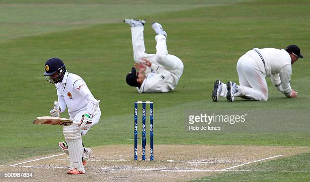 Martin Guptill of New Zealand successfully takes a catch off the bowling of Tim Southee to dismiss Dinesh Chandimal of Sri Lanka during day three of...