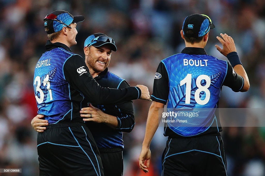 Martin Guptill of the Black Caps celebrates with Brendon McCullum and Trent Boult of the Black Caps after winning the One Day International match between New Zealand and Australia at Eden Park on February 3, 2016 in Auckland, New Zealand.