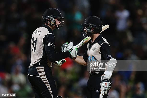 Martin Guptill of the Black Caps congratulates Kane Williamson of the Black Caps after scoring fifty runs during the International Twenty20 match...