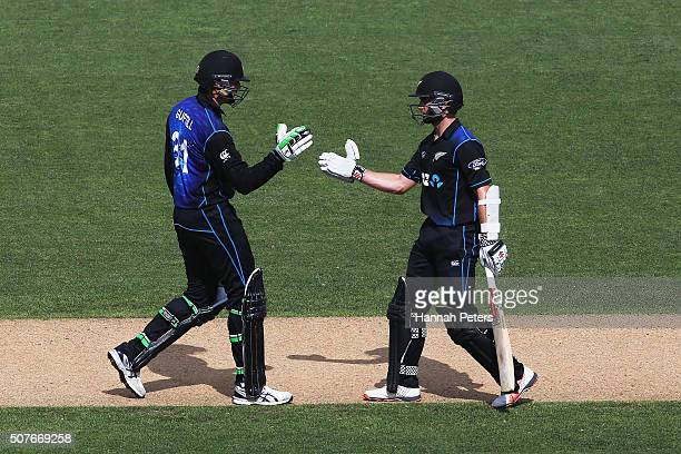 Martin Guptill of the Black Caps congratulates Kane Williamson of the Black Caps after scoring 100 run partnership during the One Day International...