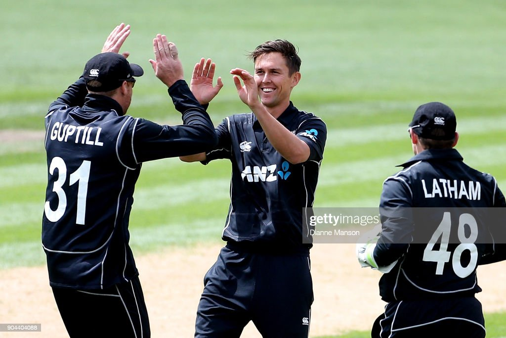Martin Guptill, Trent Boult and Tom Latham of New Zealand celebrate the dismissal of Fakhar Zaman of Pakistan during the third game of the One Day International Series between New Zealand and Pakistan at University of Otago Oval on January 13, 2018 in Dunedin, New Zealand.