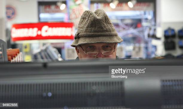 Martin Hacker looks over a 52' flatscreen television inside a PC Richard Sons store in New York US on Thursday Jan 31 2008 With January the...