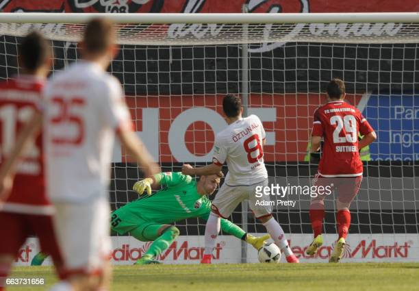 Martin Hansen of Ingolstadt saves a shot by Levin ztunali of Mainz during the Bundesliga match between FC Ingolstadt 04 and 1 FSV Mainz 05 at Audi...