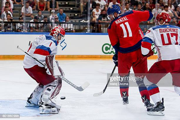 Martin Hanzal of Czech Republic and tries to score over Semyon Varlamov of Russia during the 2016 World Cup of Hockey preparation match between Czech...