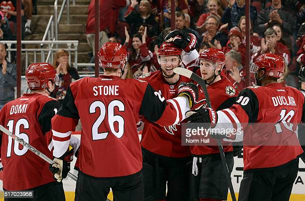 Martin Hanzal of the Arizona Coyotes celebrates with teammates Max Domi Michael Stone Oliver EkmanLarsson and Anthony Duclair after his second period...