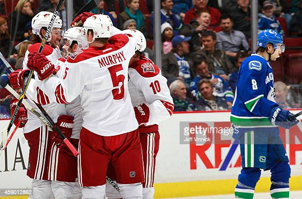 Martin Hanzal of the Arizona Coyotes is congratulated after scoring against the Vancouver Canucks during their NHL game at Rogers Arena November 14,...