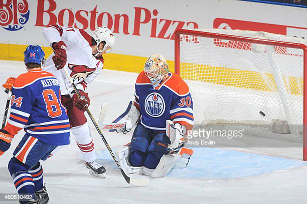 Martin Hanzal of the Arizona Coyotes scores a goal on Ben Scrivens of the Edmonton Oilers on December 23 2014 at Rexall Place in Edmonton Alberta...