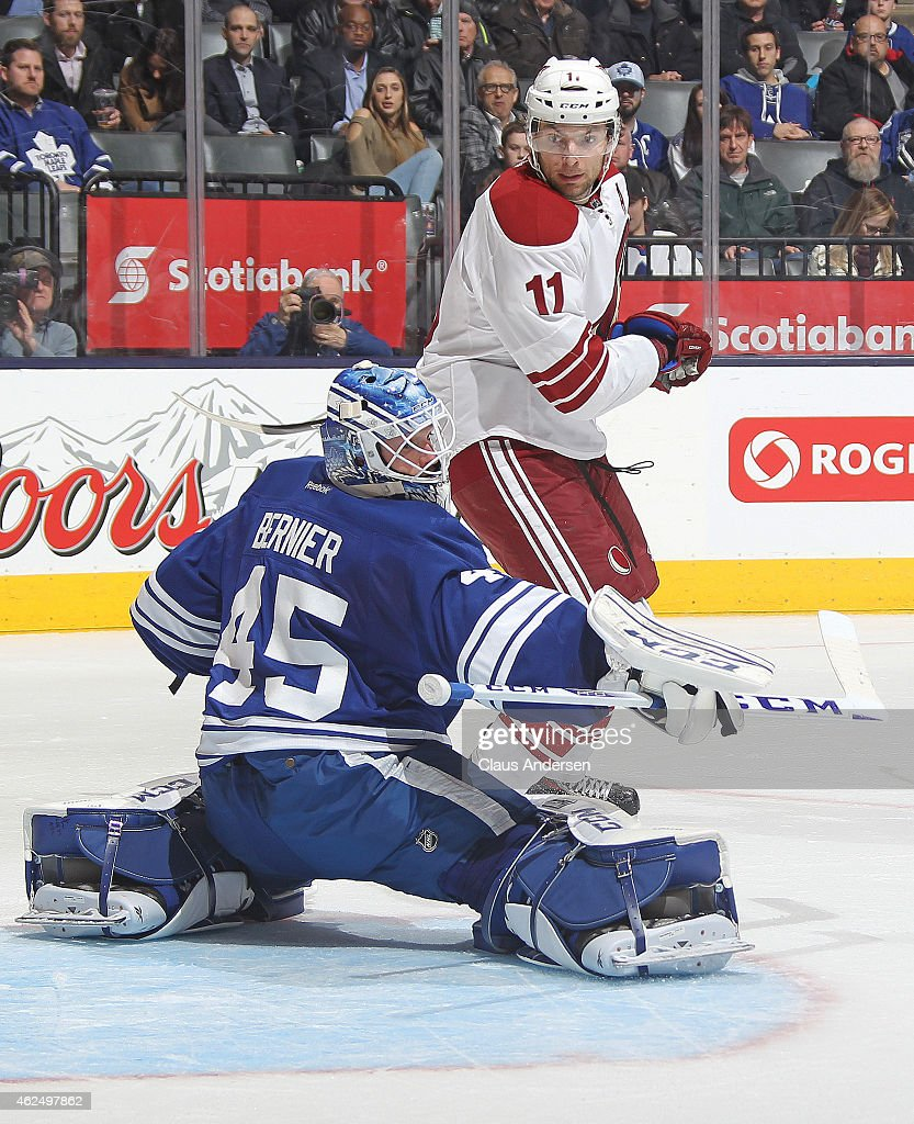 Martin Hanzal #11 of the Arizona Coyotes watches a shot tip wide of Jonathan Bernier #45 of the Toronto Maple Leafs during an NHL game at the Air Canada Centre on January 29, 2015 in Toronto, Ontario, Canada. The Coyotes defeated the Leafs 3-1.