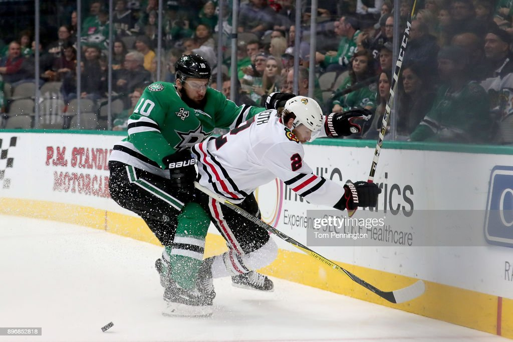 Martin Hanzal #10 of the Dallas Stars battles for the puck against Nick Schmaltz #8 of the Chicago Blackhawks in the first period at American Airlines Center on December 21, 2017 in Dallas, Texas.