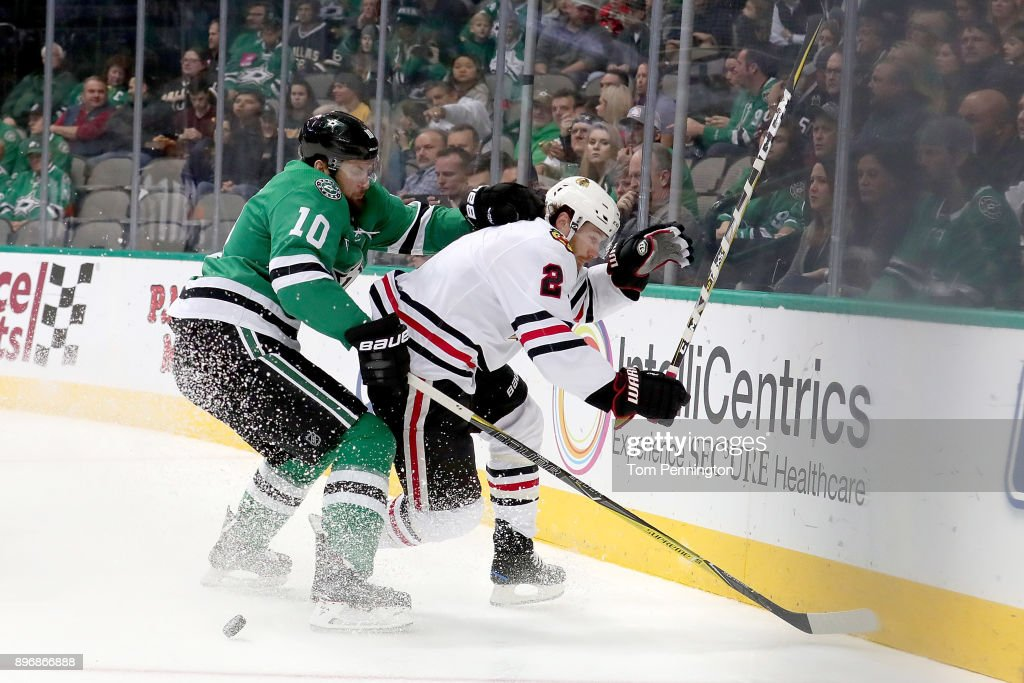 Martin Hanzal #10 of the Dallas Stars checks Duncan Keith #2 of the Chicago Blackhawks in the second period at American Airlines Center on December 21, 2017 in Dallas, Texas.