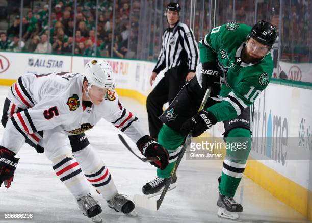 Martin Hanzal of the Dallas Stars makes a pass to a teammate against Connor Murphy of the Chicago Blackhawks at the American Airlines Center on...