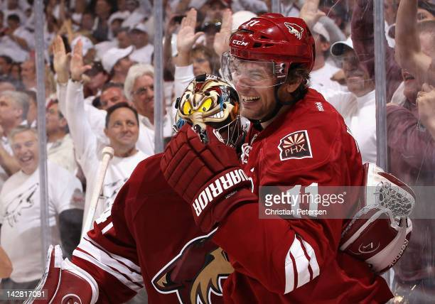 Martin Hanzal of the Phoenix Coyotes celebrates with goaltender Mike Smith after Hanzal scored the game winning goal in overtime of Game One of the...