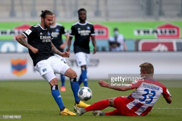 Martin Harnik of Hamburger SV and Timo Beermann of 1.FC Heidenheim 1846 battle for the ball during the Second Bundesliga match between 1. FC...