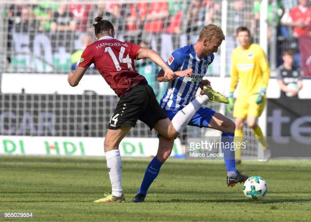 Martin Harnik of Hannover 96 and Fabian Lustenberger of Hertha BSC during the Bundesliga game between Hannover 96 and Hertha BSC at HDI Arena on May...