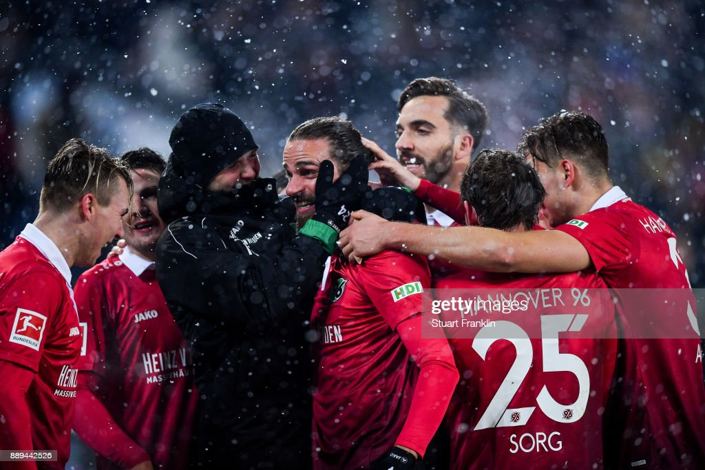 Martin Harnik #14 of Hannover 96 celebrates with his team-mates after scoring his team's second goal to make it 2-0 during the Bundesliga match between Hannover 96 and TSG 1899 Hoffenheim at HDI-Arena on December 10, 2017 in Hanover, Germany.