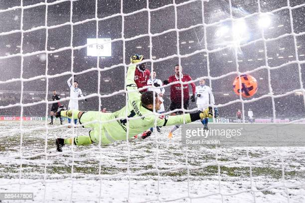 Martin Harnik of Hannover 96 scores with team's second goal against Oliver Baumann of 1899 Hoffenheim to make it 2-0 during the Bundesliga match...