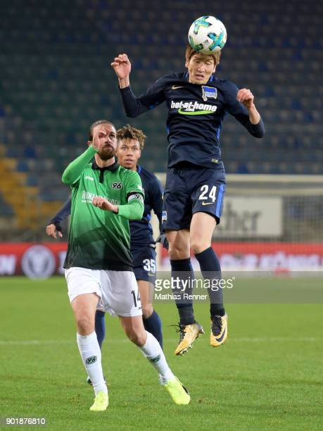Martin Harnik of Hannover 96 Sidney Friede and Genki Haraguchi of Hertha BSC during the HHotelscom Wintercup match between Hertha BSC and Hannover 96...