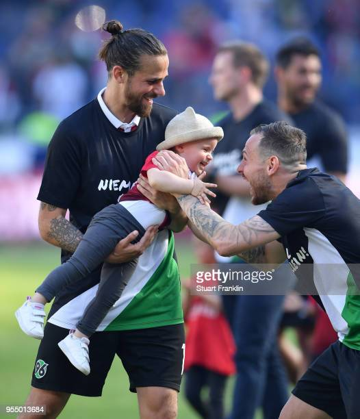 Martin Harnik of Hannover and child after the Bundesliga match between Hannover 96 and Hertha BSC at HDIArena on May 5 2018 in Hanover Germany