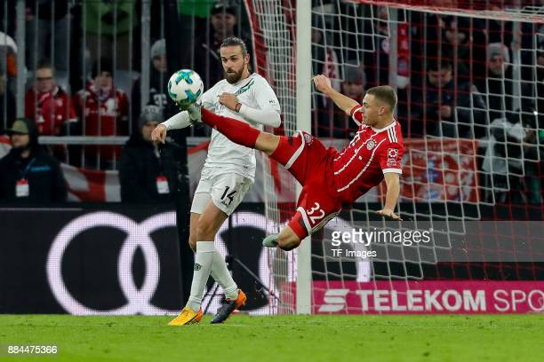 Martin Harnik of Hannover and Joshua Kimmich of Bayern Muenchen battle for the ball during the Bundesliga match between FC Bayern Muenchen and...