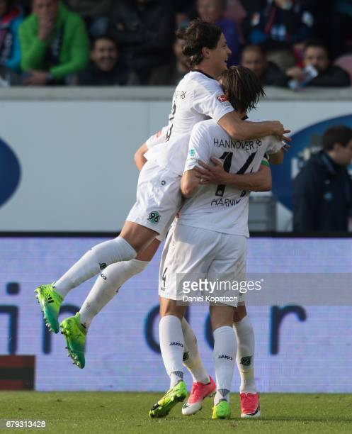 Martin Harnik of Hannover celebrates his team's second goal with team mates Marko Maric and Edgar Prib during the Second Bundesliga match between 1...