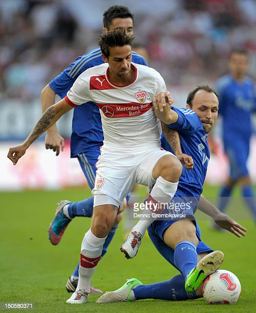 Martin Harnik of Stuttgart and Gordon Schildenfeld of Moscow battle for the ball during the UEFA Europa League Qualifying PlayOff match between VfB...