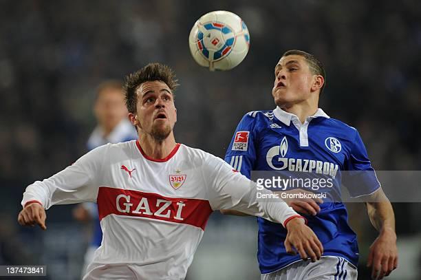 Martin Harnik of Stuttgart and Kyriakos Papadopoulos of Schalke battle for the ball during the Bundesliga match between FC Schalke 04 and VfB...