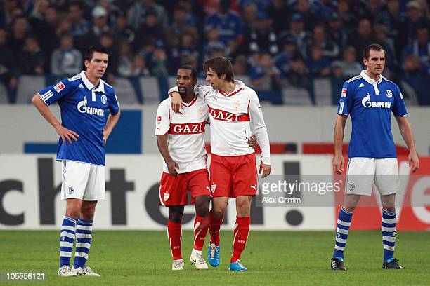 Martin Harnik of Stuttgart celebrates his team's second goal with team mate Cacau as they walk between Christoph Moritz and Christoph Metzelder of...