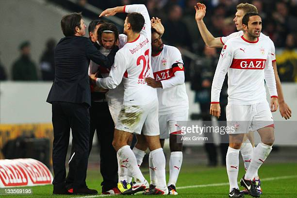 Martin Harnik of Stuttgart celebrates his team's second goal with team mates and head coach Bruno Labbadia during the Bundesliga match between VfB...