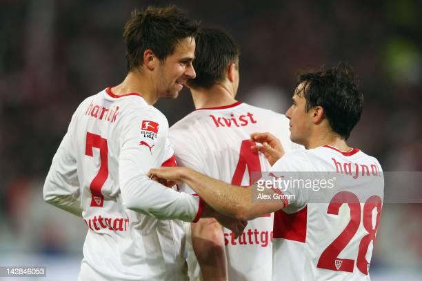 Martin Harnik of Stuttgart celebrates his team's second goal with team mates William Kvist and Tamas Hajnal during the Bundesliga match between VfB...