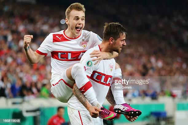 Martin Harnik of Stuttgart celebrates his team's second goal with team mate Alexandru Maxim during the DFB Cup Semi Final match between VfB Stuttgart...