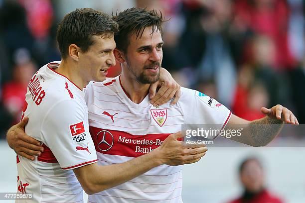 Martin Harnik of Stuttgart celebrates his team's second goal with team mate Daniel Schwaab during the Bundesliga match between VfB Stuttgart and...