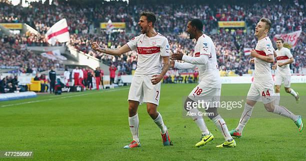 Martin Harnik of Stuttgart celebrates his team's second goal with team mates Cacau and Alexandru Maxim during the Bundesliga match between VfB...